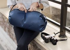 Simply lay the bag flat and put your belongings in the center.