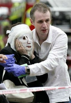 7 July 2005: A wounded victim is helped at Aldgate Station after a series of blasts rocked London's transport networks just a day after the city won its bid to host the 2012 Olympic Games. Three bombs exploded on the London Underground and one on a bus, killing 52 civilians and four terrorists.~Another horrific event, emergency services were wonderful & saved many lives~