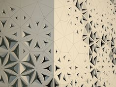 A screen wall facade of folded powder coated steel panels Lisa Iwamoto and her husband designed for a home in Bruges, the Belgian center of lacemaking.