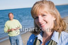 """Clipart.com Closeup   Royalty-Free Image of outdoor, day, """"one person with others"""", adult, Caucasian, redhead, """"red hair"""", """"middle-aged woman"""", """"45-50 years"""", """"50-55 years"""", """"head and shoulders"""", smiling, """"eye contact"""", beach, sand, ocean, sea, water, lake, horizon, sky, leisure, lifestyle, """"casual attire"""", portrait"""