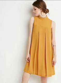 This modern day shift dress is similar to the 1960's dress in its shape and color. Both dress feature a yellow tone, and are loose fitting with the high collar and yoke. - Bridgette B. 4/20/18