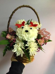 Puppy arrangement created using white carnations and white Cushion Poms.  Fun for ANY occasion.