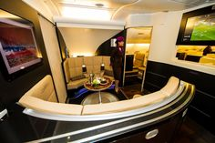 """Boarding the Etihad A380 is like entering a luxury hotel - passing through the """"lobby"""" on the way to my business studio Photo: Jacob Pfleger 