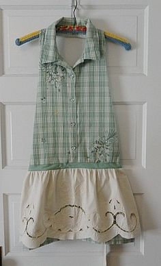 This apron has so many great features, some of which include the pretty machine embroidered flower accents on the sage and seafoam green plaid