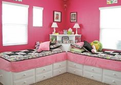 two twin beds with built in elevated shelves behind them