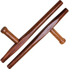 WOODEN RED OAK ROUND TONFA The dense hard wood of the tonfa protects against sword cuts and sits comfortably on the forearm when gripped at the handle. This item is a practice training aid only and should not be used for full contact training.