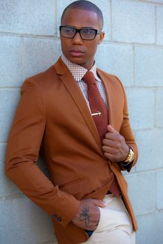 Great use of orange and notice the blue lining and buttons of the jacket. Great color scheme and works especially well with brown/ tanned skins. Not that great for really white people. I wish it would...