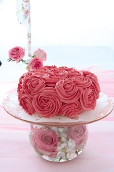 Create a cake stand with a delightful difference simply by combining a rose bowl arrangement with a pretty glass plate.