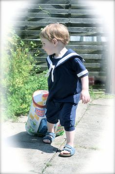 Finally available at Swellrenditions is this super cute, nostalgic and vintage looking Sailor suit for little boys. Its made from a soft, stretchy cotton jersey, decorated with white ribbon. The waistband on the pants is elasticated for a comfy fit. Just the perfect mix of old fashioned cuteness and modern comfort and convenience. The suit will be made in navy blue, but if youd prefer a different color, please let me know and Ill see what I can do. The cute suit is available for ages 1/2...