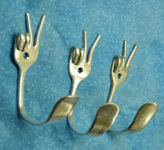 Do you want an unusual design idea that will look stunning in your kitchen? Take some old metal forks and make pretty-looking and unique wall hooks out of them. Using a hammer and some pliers, you can bend the forks to create almost any shape. And don't forget to drill a pilot hole for the screw.