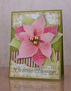 Silver heat-embossed Poinsettia (stamp from Waltzingmouse) card by Nerina