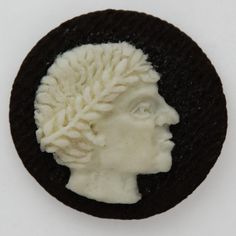 Classic Roman Portraits carved into Oreo cookie cream by Judith G. Klausner