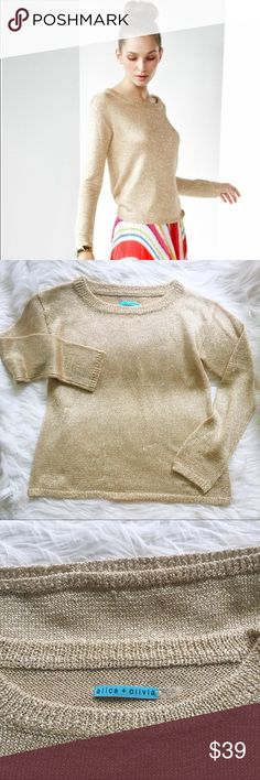 """Alice + olivia gold Ethan sweater *read* I want to state upfront this lovely sweater does have some pulls and the beginnings of a small hole near the waistband. That said it is still a gorgeous sweater and could be worn casually – I have priced it accordingly. Scoopneck metallic sweater with ribbed edges. Long sleeves, semi sheer. Size medium. 37"""" bust. 22"""" sleeve. 23"""" length from back collar. 78% acetate 12% metallic polyester 10% polyamide. Alice + Olivia Sweaters Crew & Scoop Necks"""