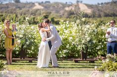 Large Ceremony Arrangements of Curly Willow Branches, Eucalyptus & Hydrangea. Waller Weddings