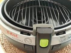 """**HOW TO MAKE YOUR T -FAL #ACTIFRY MORE VERSATILE** - (Purchase a 9 1/2"""" round cooling/baking rack and gently pry the center of the rack apart so the mechanism still turns but does not touch the rack) - Voila! you now have another level . You can now bake two levels of delicate foods or add last minute foods to the top rack♥ TIP: Slightly tip the rack to go under the front lip and then press down GENTLY ON THE BACK.- Your rack will not move around if it is 9 1/2 """"!!"""