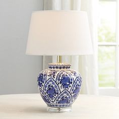 A classic silhouette in timeless blue and white. Our Round Table Lamp Base is crafted of ceramic with flowing floral motif. A clear acrylic base adds a light, modern note.