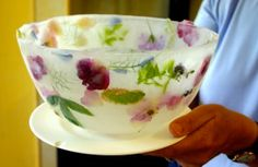 Wonderful frozen ice bowls using seasonal flowers to decorate them. It is really easy to do, I have wonderful memories of my mother serving us ice cream and fruit salad in beautiful big frozen flower ice bowls outside on a hot summers day.