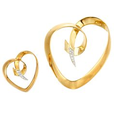 Two Gold, Platinum and Diamond Heart Brooches, Tiffany & Co., Paloma Picasso   18 kt., both signed Tiffany & Co., Paloma Picasso, 1983, ap. 12 dwt. With signed box.