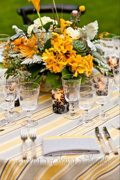 Daily Pretty:  Wild centerpiece containing spider mums, orchids, lemon leaf, dusty miller, succulents, calla lilly, berries, billy balls, seeded eucalyptus and spray roses on a mustard toned cake stand on a striped linen with damask votives, country etched glassware and mother of pearl flatware.  Image by @Damion Hamilton-Photographer
