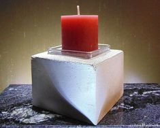 This is a cuboid shaped cement candle holder that can be used as a succulent planter small pencil holder paperweight paperclip holder There is pictured This listing is for ONE Cement, Concrete, Pencil Holder, Paper Clip, Paper Weights, Shot Glass, Candle Holders, Planters, Christmas Gifts