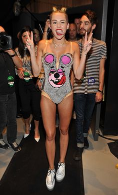 Miley Cyrus..is one of those people that makes me sick to look at her.  Her parents should be ashamed of her.  I can listen to her music as long i dont have to look at her.