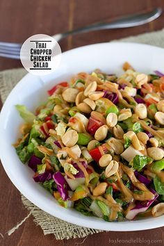 This Thai Chopped Chicken Salad is filled with flavor - lettuce, cabbage and vegetables come together with marinated chicken, a sweet Thai salad dressing and a flavorful peanut sauce.
