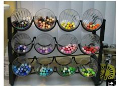 Inexpensive tabletop wine rack, plastic cups--instant pen organizer.