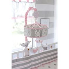 The Olivia Rose circle mobile in gray damask with pretty birds will be sure to calm your baby! Wind-up mobile plays Brahms Lullaby.