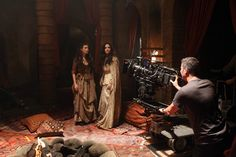 """ONCE UPON A TIME - """"Child of the Moon"""" - Series stars Meghan Ory (Red Riding Hood) and Ginnifer Goodwin (Snow White) film a scene in a wolves' den."""