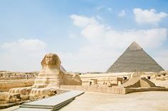 picture of great pyramids - landmark of famous Great Sphinx from century XXVI Before Christ and behind the Great Pyramid of Khafre in Giza next to Cairo city Egypt Africa - JPG