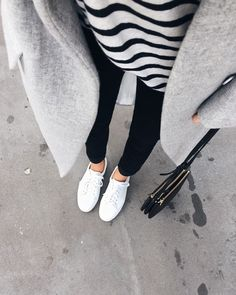 View from here - minimal and classic - grey coat, black + white striped tee, black jeans & white sneakers - Céline