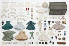 Doll with her outfits and trunk, circa 1865.