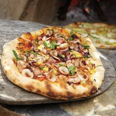 Michael Emanuel (an alumnus of Berkeley's Chez Panisse) tops this pizza with an irresistible mix of Provençal flavors: salty-sweet roasted squid, cre... - #dairy_free pizza uses aioli instead of cheese