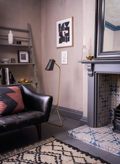 The living room of Lee Thornley, founder of Bert & May, a boutique interiors and homeware store. The picture features a fireplace with hand painted tiles and a leather sofa. Images by Interiors photographer Alexander Edwards Boutique Interior, A Boutique, Bert And May Tiles, Sofa Deals, Painted Tiles, Hand Painted, Best Leather Sofa, Buy Sofa, Couch Set