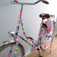 Bike decorated with washi and duct tape - http://craftideas.bitchinrants.com/bike-decorated-with-washi-and-duct-tape/