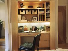 i so wish we had a hall closet so that i could do this with our office - neatly tuck it away. the only closets like this are in the boys' rooms... i'm not THAT mean :)