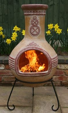 A chiminea (chim-eh-ney-ah) is a freestanding front-loading fireplace or oven with a bulbous body and usually a vertical smoke vent or chimney.