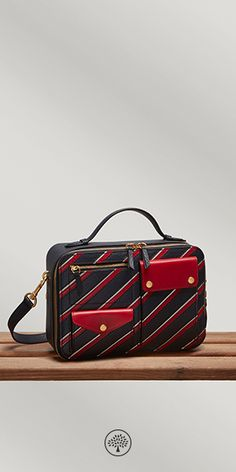 The Cherwell draws on the collection's theme of utility with its rectangular box shape and array of pockets overlaying the bag's surface. Finished with a zip fastening, it opens up to a velvety suede interior, equipped with a slip pocket.
