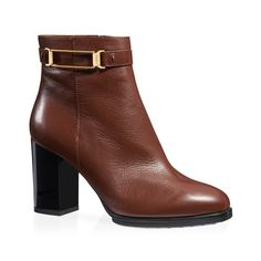 Elegant leather ankle boots featuring a semi-glossy finish with ankle strap, designer metal embellishment, zip on the side, rubber outsole with embossed rubber pebbles and lacquered heel.