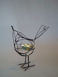 Jill Walker. I find the bead in the middle is distracting. Wirework excellent.