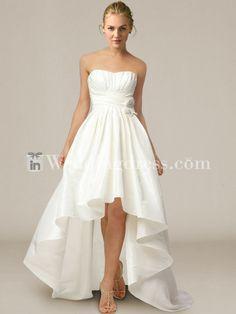 Casual wedding dress features in taffeta. Strapless high low mini ball gown with draped bodice. Sweep train. Hidden back zipper. #weddingdress