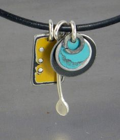 This funky charm pendant is made using vintage automotive steel. The yellow rectangle was taken off a 40's GMC bat wing hood, the black circle came off a 73 Ford and the turquoise circle from a 60's Dodge pickup