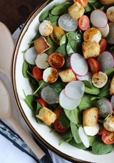 This fresh spinach salad is such a simple recipe to throw together for your Easter brunch. Filled with freshly toasted croutons, chopped cherry tomatoes, and radishes, this salad is the perfect option for springtime—and it takes just a few minutes to make!