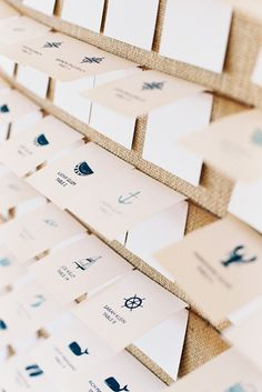 escort cards on a board with mini animal icons