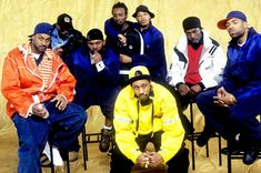 """This is 1990s hip-hop fashion. Hip-hop originated in the South Bronx. Men wore baggy pants, hats turned around backwards, and high running shoes with untied laces. """"Clothes were oversized, pants worn low on the waist."""" There were also large necklaces worn as well."""
