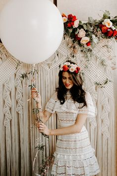 My Spanish Themed Bridal Shower in Miami with a macrame photo backdrop from Yerbamala designs. Wearing a self portrait white dress