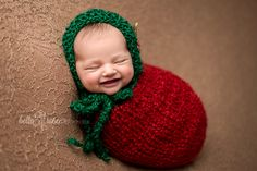 Newborn boy Christmas setup red, green, and gold swaddle sack and bonnet | Bella Rose Portraits Oceanside, CA newborn photographer