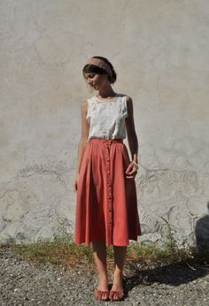 simple white top with a faded red skirt