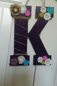 A wooden K that we painted and decorated to put on Kaylas dorm room door