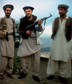 Current Prime Minister of Denmark, Lars Løkke Rasmussen, posing with mujahideen fighters holding an AK-47 - Afghanistan, 1988, pin by Paolo Marzioli